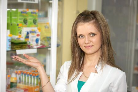 Chemist woman standing in pharmacy drugstore. A female portrait Stock Photo - 13845477