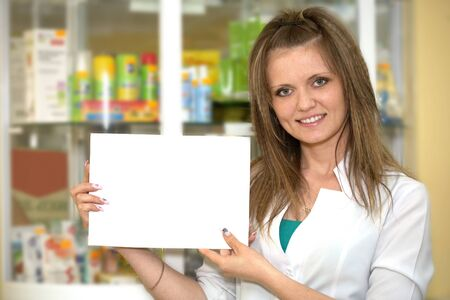 Medicine. Chemist woman standing in pharmacy drugstore. Paper Stock Photo - 13845458