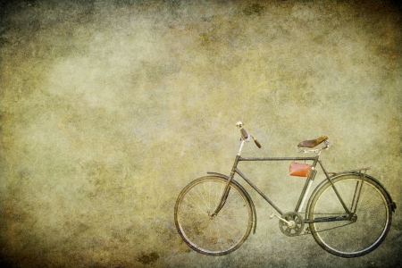 The old bicycle on the old brown paper photo