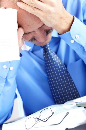 Businessman having stress in the office. Crisis photo