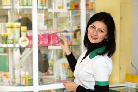 Chemist woman standing in pharmacy drugstore. Medicine Stock Photo - 16110059