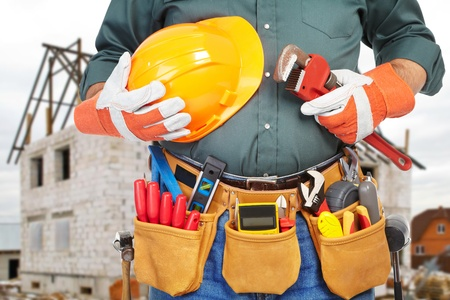 housebuilding: Mature contractor working. House-building. Worker
