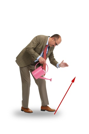 wateringcan: The businessman with pink watering-can on a white background
