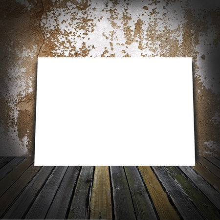 Sheet of a paper in a room  Wall old room background and wooden floor photo