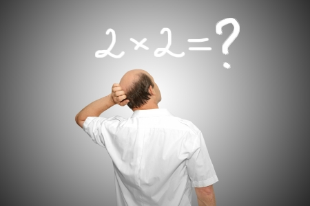 formulation: The businessman looks at the formula and thinks