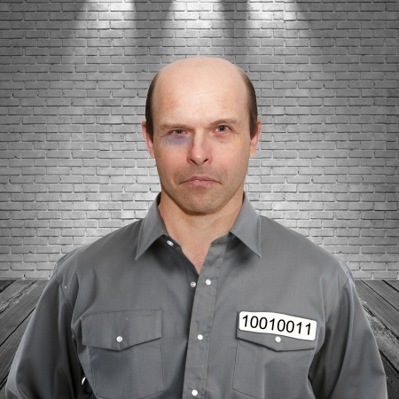 Portrait of a criminal in prison cell on a white background Stock Photo