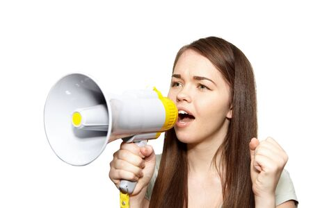 The young beautiful woman with megaphone on a white background Stock Photo - 20646227