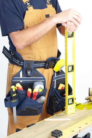 metre: Contractor working with metre measure ruler. The carpenter