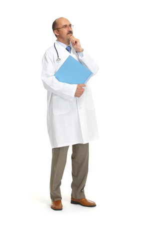 mature doctor: The doctor with the book and stethoscope on a white background Stock Photo
