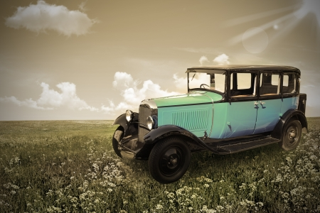 The retro car stands in a field.  photo