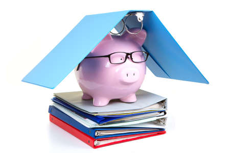 Pink piggy bank and documents on a white background photo