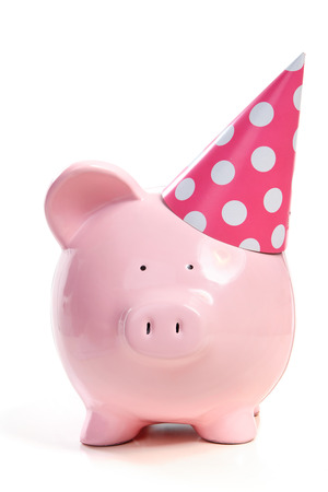 The pink  pig in a cap on a white background photo