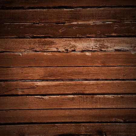 Grunge wooden wall used as background. Wood texture with natural patterns photo