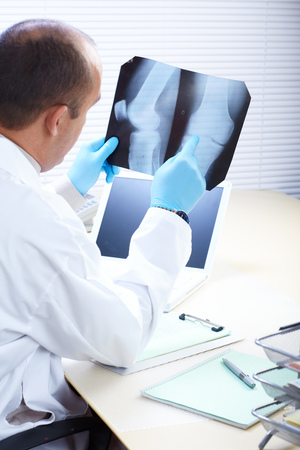 Doctor examining an x-ray. Medicine and health-care photo