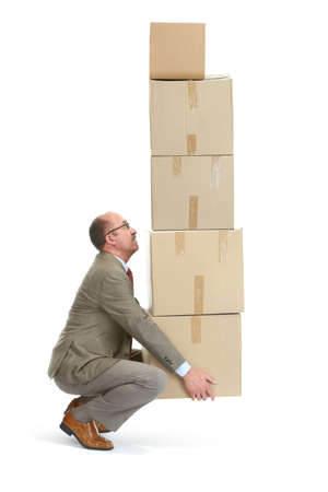 Businessman and a cardboard boxs on a white background photo