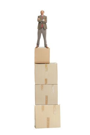 Businessman and a cardboard box on a white background photo