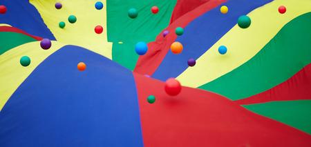 mirth:  The multicoloured balls on multicoloured shawl. The childish sports  Stock Photo