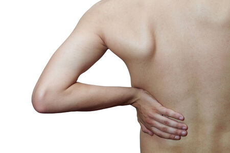 diseased: Young male holding his back in pain. On a white background