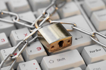 interdiction: Lock and white keyboard.  Interdiction and chain