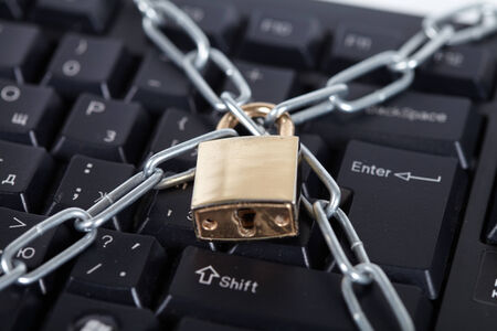 interdiction: Lock and black keyboard.  Interdiction and chain