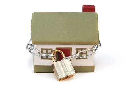 padlock shut off: House and yellow lock. Toy and chain Stock Photo