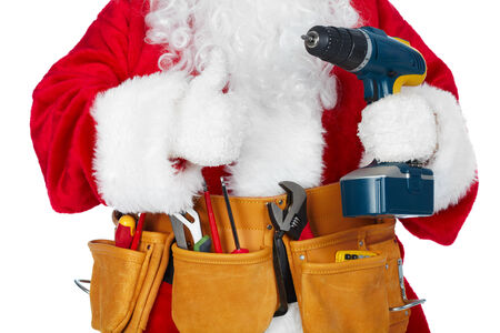 Santa Worker with a tool belt over white background. photo