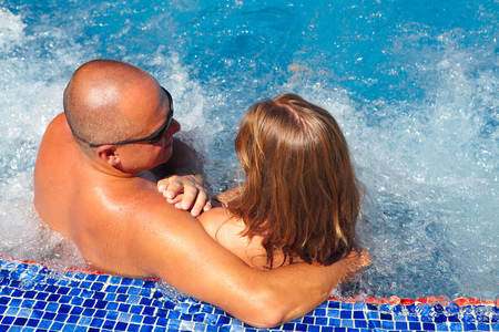 water hottub: Loving happy couple in hot-tub. Summer vacation.