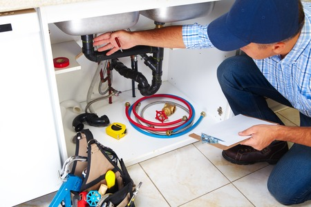 sink drain: Plumber with Plumbing tools on the kitchen. Renovation.