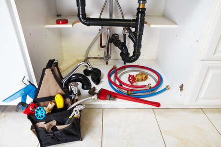 kitchen renovation: Plumbing tools on the kitchen. Renovation  background.