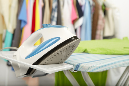 electric iron: Electric iron and shirt, on cloth background