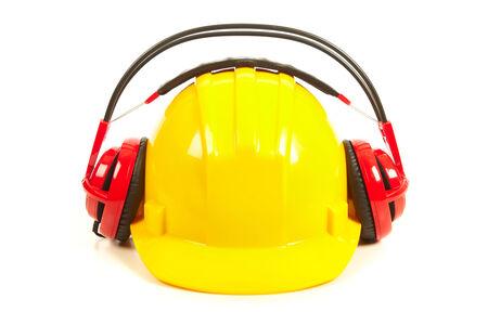 Helmet and headphones isolated on white background photo