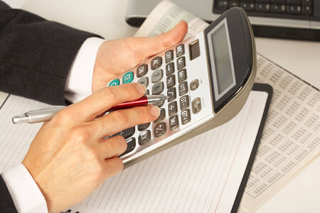 compute: Businesswoman working with calculator in the office