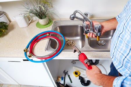 water faucet: Plumber on the kitchen. Renovation  and plumbing.
