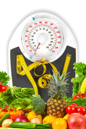 A bathroom scale with a measuring tape, weight loss concept Standard-Bild