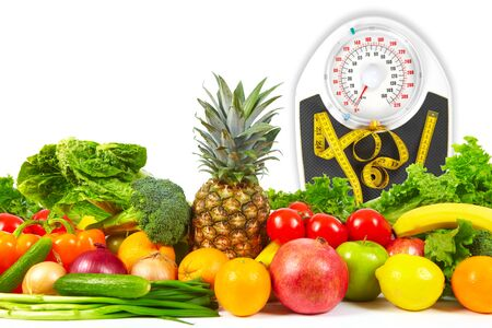 weigher: Scales and collection fruits and vegetables on a white background
