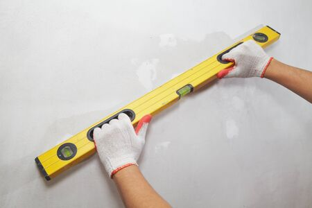 metre: Contractor working with metre measure ruler. The builder Stock Photo