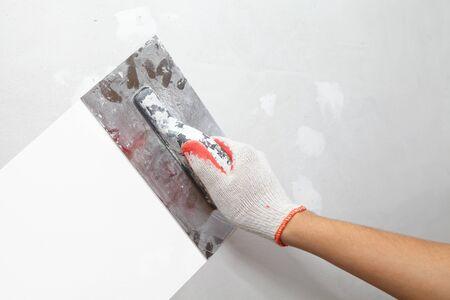plasterwork: Mature contractor plasterer working indoors. Construction. Worker Stock Photo