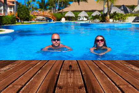 bikini construction: Happy couple swimming in pool. Sport and recreation background