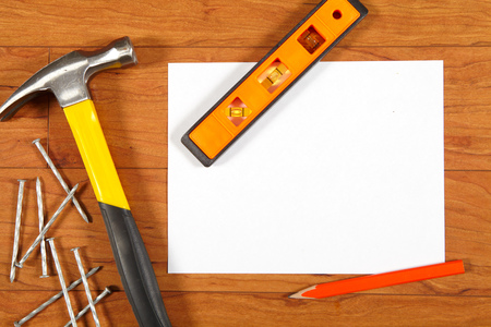 hobnail: Construction tools and sheet of paper lying on a wooden floor Stock Photo