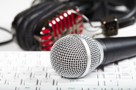 stage: Microphone and headphones on the keyboard. Music and singing