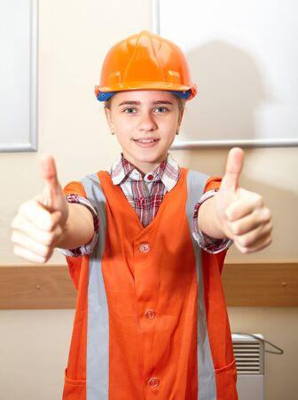 herramientas de construccion: Young contractor shows gesture in the office. Construction Foto de archivo