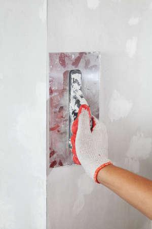 plasterer: Mature contractor plasterer working indoors. Construction. Worker Stock Photo