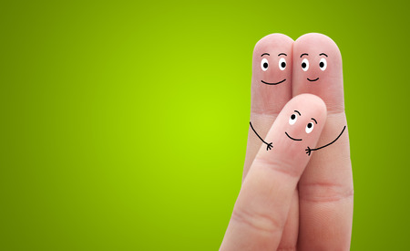 man woman hugging: A happy family in love on green background