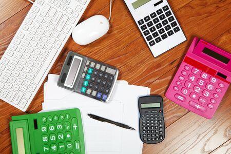 compute: Many calculators lying on the wooden flooring