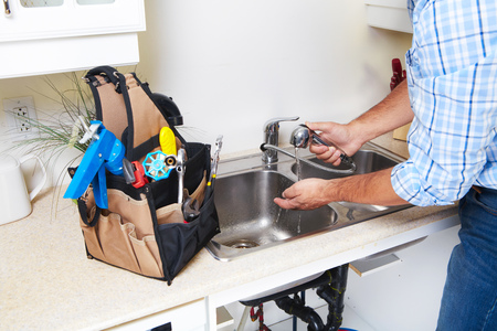 kitchen renovation: Plumber on the kitchen. Renovation  and plumbing.