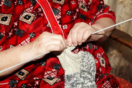 old people: Old woman and knitting clothes. Senior people