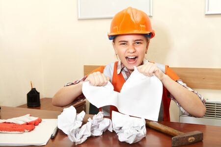 fury: Young contractor in the office. Stress and fury Stock Photo