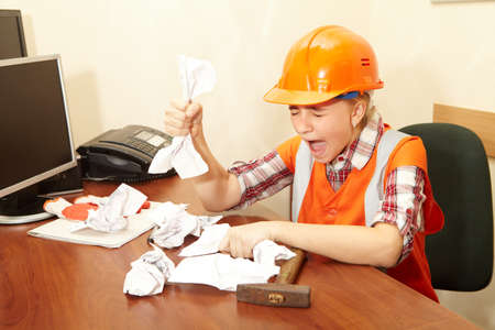 spite: Young contractor in the office. Stress and fury Stock Photo