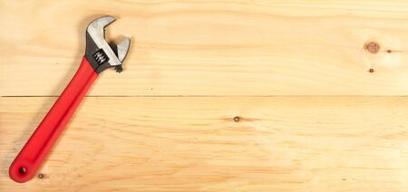 toolset: Wrench on wooden background