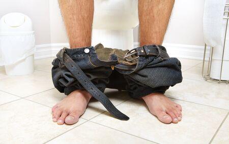 lavatory: Adult male sitting on the lavatory pan. Diarrhea Stock Photo